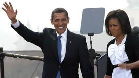 Manželé Obamovi v Praze