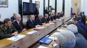 Ruský prezident Vladimír Putin na zasedání Bezpečnostní rady v Kremlu (22.7.2014).