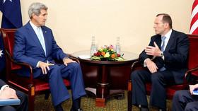 Tony Abbott, australský premiér a John Kerry, ministr zahraničí Spojených států