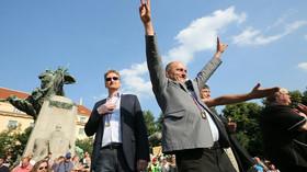 Marek Černoch a Martin Konvička na demonstraci proti uprchlíkům
