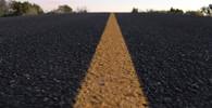 Ruska se na protest proti špatným silnicím fotila v louži - anotační obrázek
