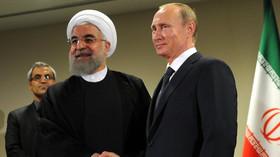Vladimir Putin, ruský prezident s prezidentem Íránu Hasanem Rúháním
