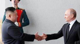 Vladimír Putin a Kim Čong-un