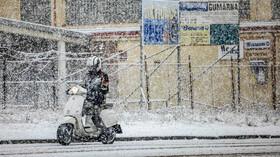 Lidé ve sněhové vánici, ilustrační foto